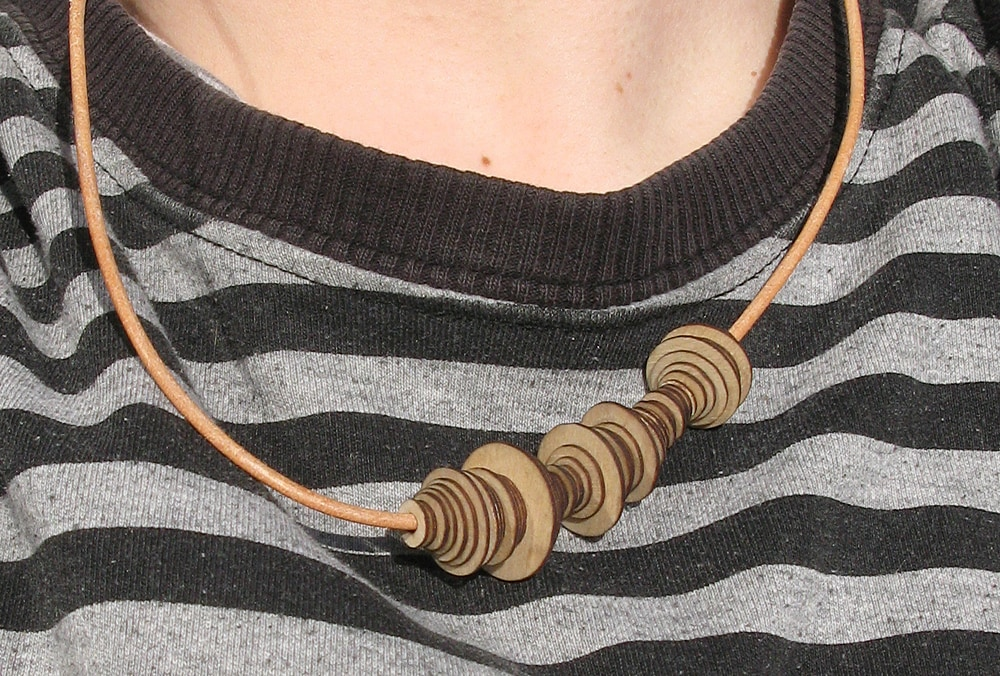 David wearing a 1mm plywood soundwave bracelet as a necklace